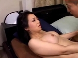 Busty-Milf-Sucking-Young-Guy-Riding-On-Him-On-The-Bed